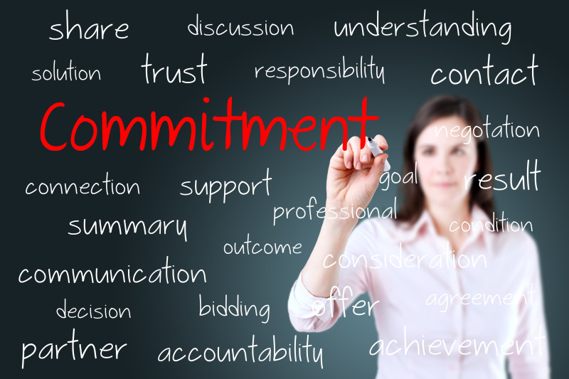 http://www.dreamstime.com/stock-photography-young-business-woman-writing-commitment-concept-image39568682